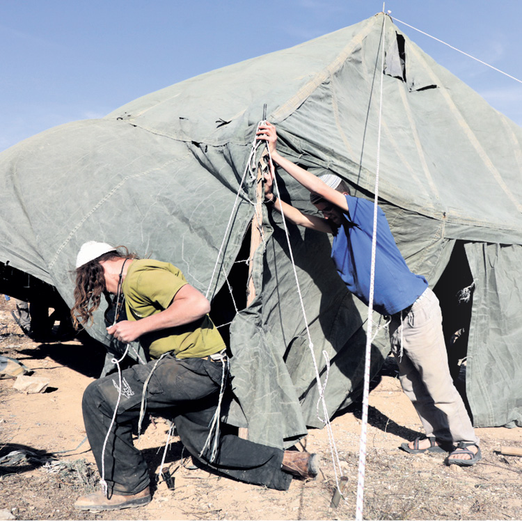 Raising tents in Amona.