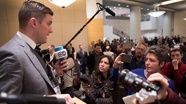Spencer addresses the press (Photo: AP)