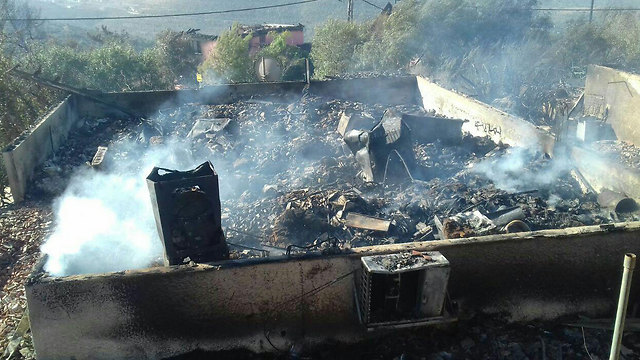 A burnt down house in the settlement of Halamish (Photo: Judea and Samaria Fire Department Spokesperson's Unit)