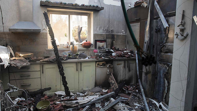 נזקים כבדים לדירות בחיפה (צילום: AFP) (צילום: AFP)