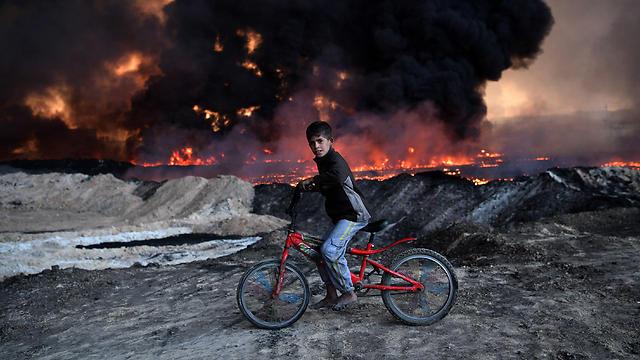 לאחר נפילת מוסול יעברו הג'יהאדיסטים למוקד הלחימה הבא - א-רקה הסורית (צילום: Gettyimages)