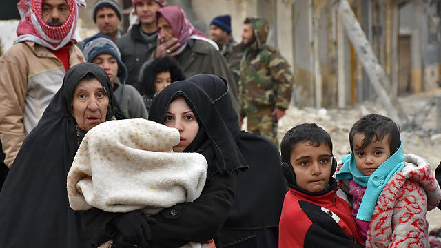 Syrian refugees from the city of Aleppo (Photo: AFP)