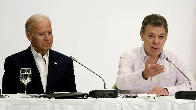 """נשיא קולומביה סנטוס עם סגן נשיא ארה""""ב ג'ו ביידן (צילום: EPA)"""