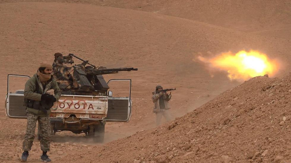 ISIS militants in the fight to retake Palmyra
