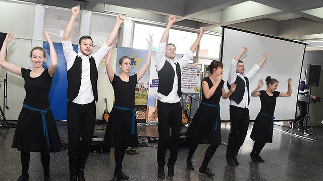 Dancing and singing to Holocaust survivors (Photo: Yair Sagi)