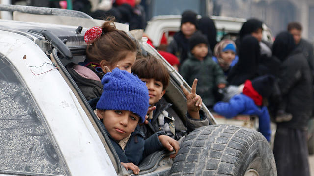 Refugees fleeing Aleppo (Photo: Reuters)