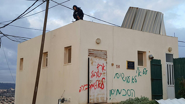 Graffiti in Amona declaring: 'You don't make agreements on the Land of Israel; the Land of Israel is not for sale' (Photo: Ido Erez)