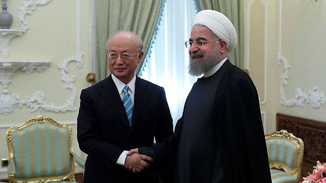 Amano meets with Rouhani during a previous visit to Tehran (Photo: AP)