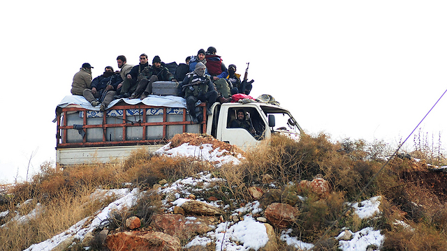Rebel fighters leaving Aleppo (Photo: AFP)