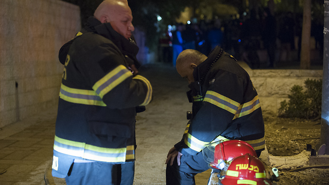 Firefighters after subduing the blaze (Photo: Yoav Dudkevitch) (Photo: Yoav Dudkevitch)