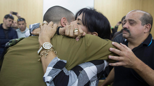 Elor Azaria with his parents following the ruling. He did not choose to be in the place he was in; the IDF sent him there, and the IDF betrayed him (Photo: EPA)