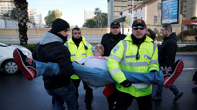A protester being arrested (Photo: Reuters)