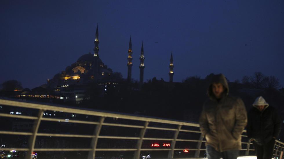People walk over the Golden Horn Bridge in Istanbul. (Photo: AP)