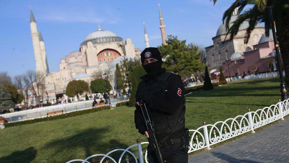 A Turkish police officer patrols the area by the Byzantine-era Hagia Sophia. (Photo: AP)