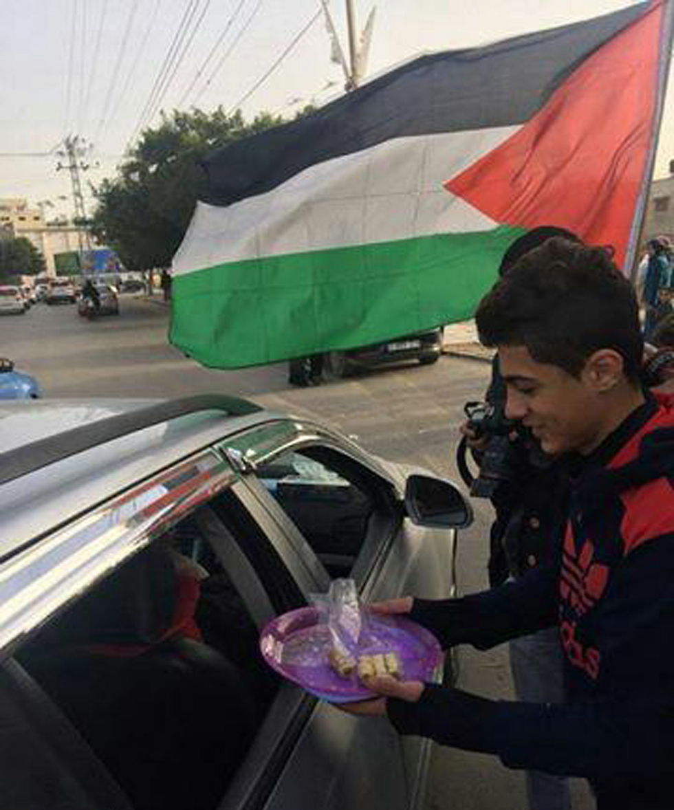 Distributing sweets in Gaza after the attack