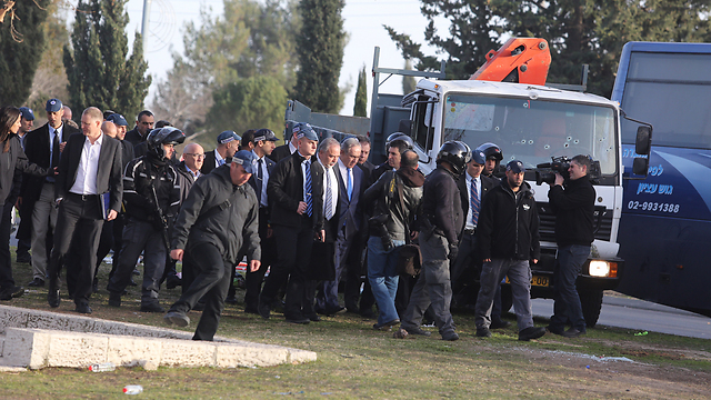 Lieberman and Netanyahu visit the site of the attack. (Photo: Gil Yohanan)