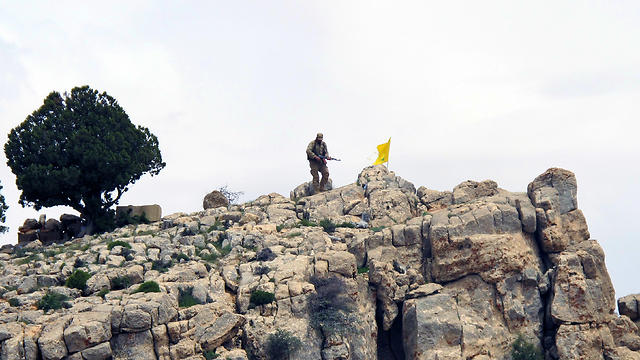 Hezbollah fighter on Syrian-Lebanese border. At this stage, Hezbollah isn't interested in a conflict with Israel for political-economic reasons (Photo: AP)