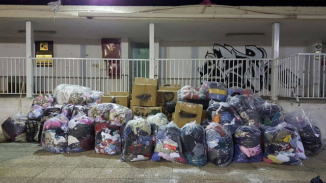 Bags of donated winter gear to be sent to Syrian refugees from Israeli citizens Photo: Youth Federation for Working and Studying