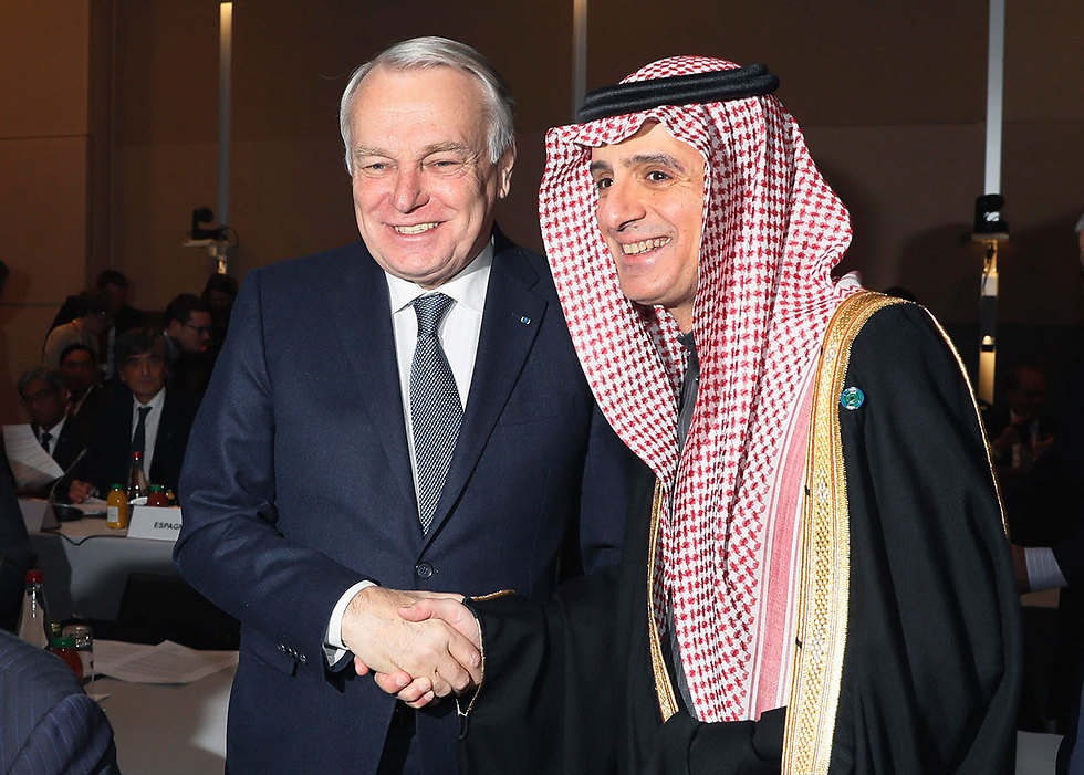 French FM with his counterpart from Saudi Arabia at the conference (Photo: AP)