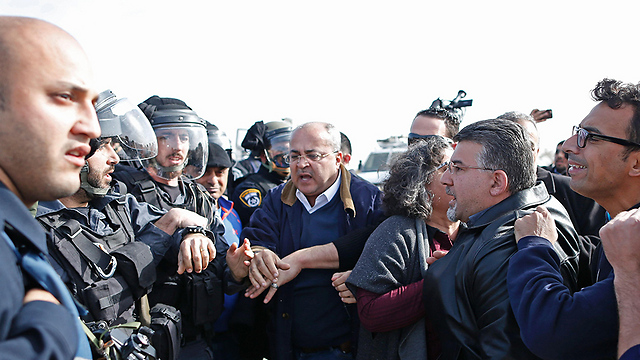 MK Ahmad Tibi in Umm al-Hiran (Photo: AFP)