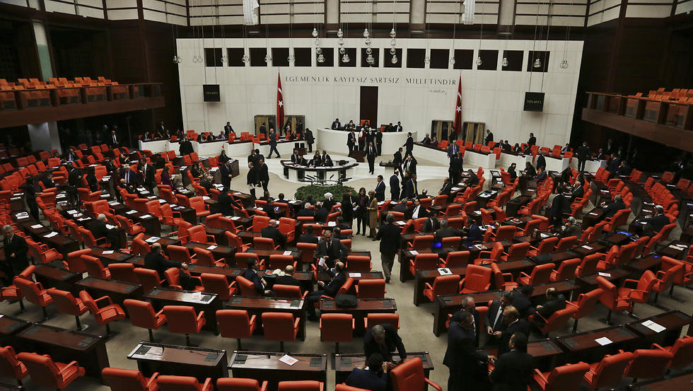 Legislators in Turkey's parliament debate proposing amendments to the country's constitution (Photo: AP)
