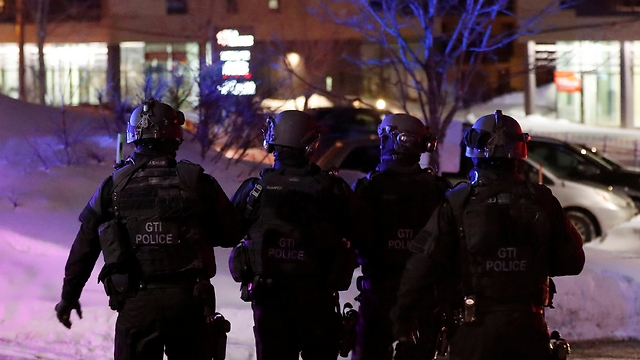 Police forces at the scene of attack in Quebec (Photo: AP)