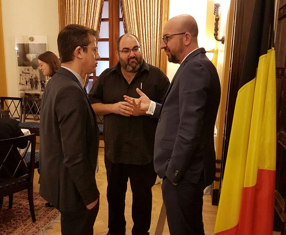Belgian PM meeting with Hagai El-Ad (L) and Yehuda Shaul