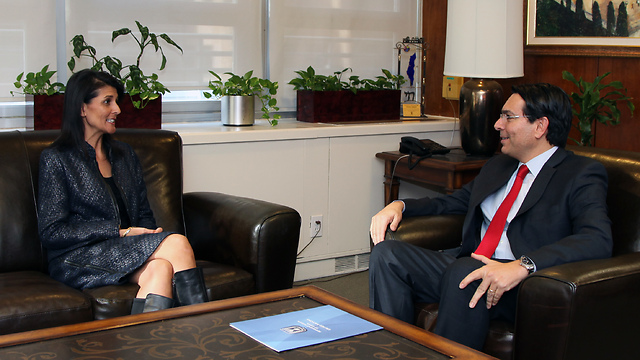 Haley (L) and Danon sit down at the UN