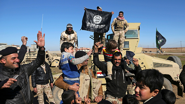 File photo of celebrants in the fight to free Mosul from ISIS in January (Photo:AP)