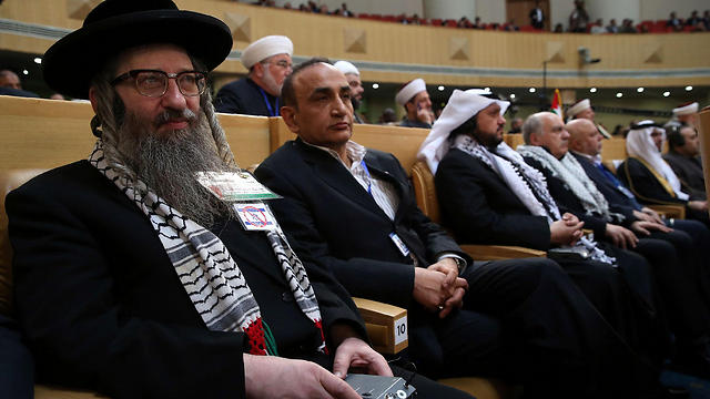 Rabbi Yisroel Dovid Weis at the conference (Photo: AFP)