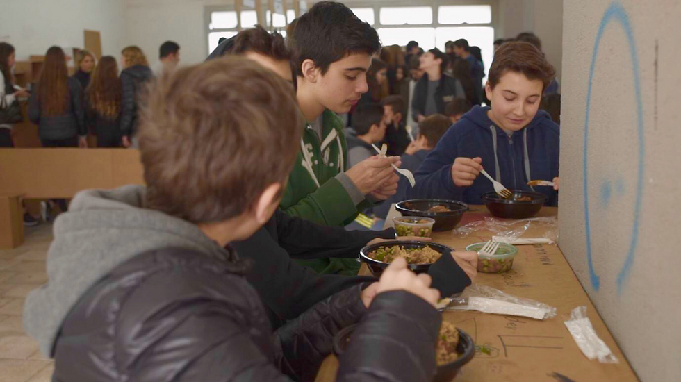 Students at Tichonet high school enjoy the new healthy meals (Photo: Amnon Hass)