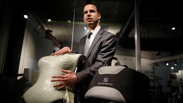 ideon Waterman, Chief Technology Officer at Stemrad, touches a prototype of the company's new protective vest, Astrorad (Photo: Reuters)