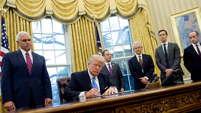 Trump signs bill (Photo: AFP)