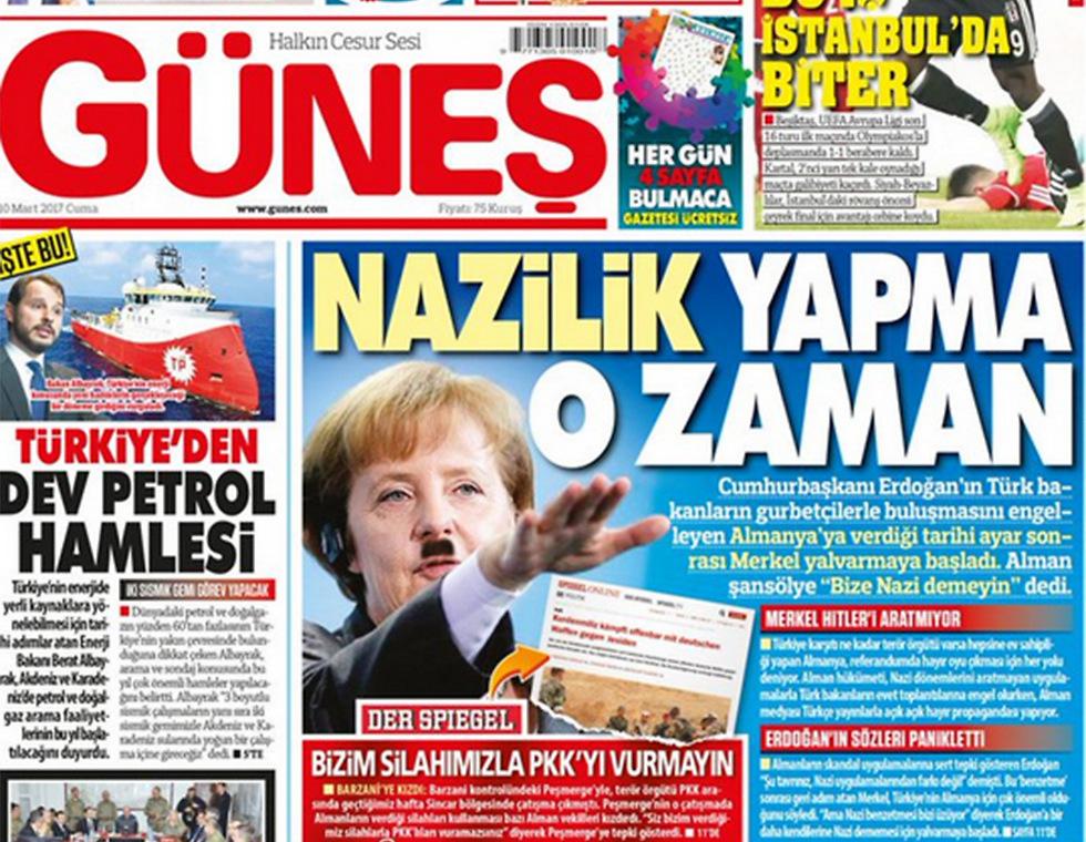 The paper featuring a Hitler-like Merkel