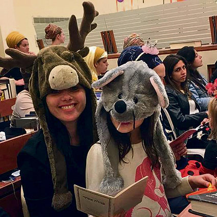 Ayelet Shaked is a deer with her daughter at the Megillah reading