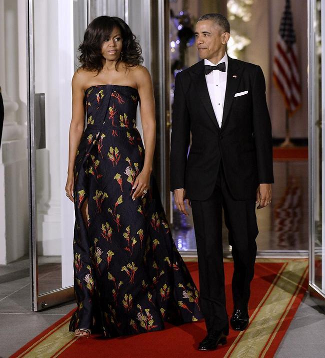 ברק ומישל אובמה (צילום: EPA)