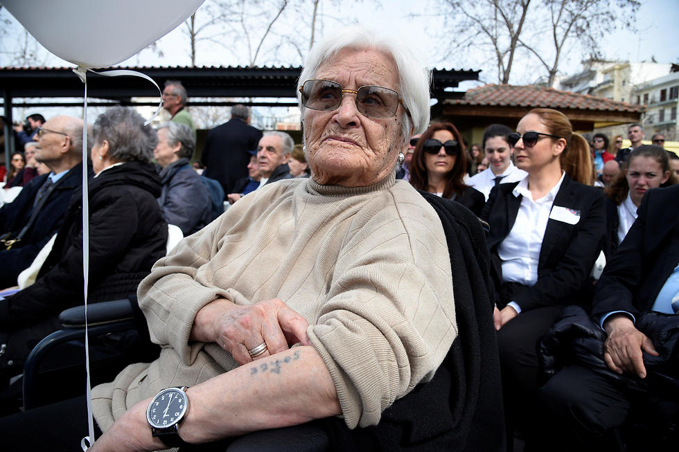 Zana Sadikario-Saatsoglou, a Jewish survivor of the Holocaust, shows her arm with a death camp number on it during the memorial (Photo: Reuters)