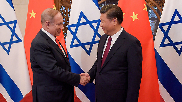 Chinese Premier Li Keqiang and Prime Minister Netanyahu during latter's latest trip to China (Photo: Getty Images)