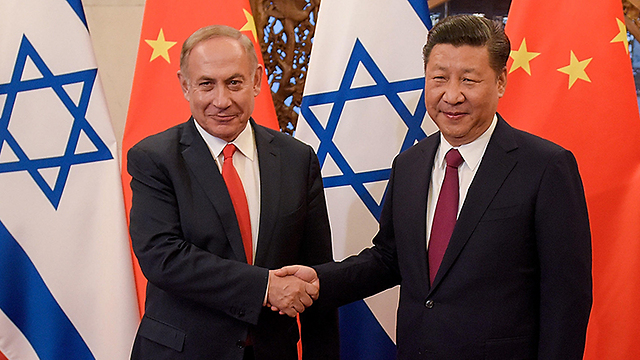 Prime Minister Benjamin Netanyahu with Chinese President Xi Jinping (Photo: Getty Images)