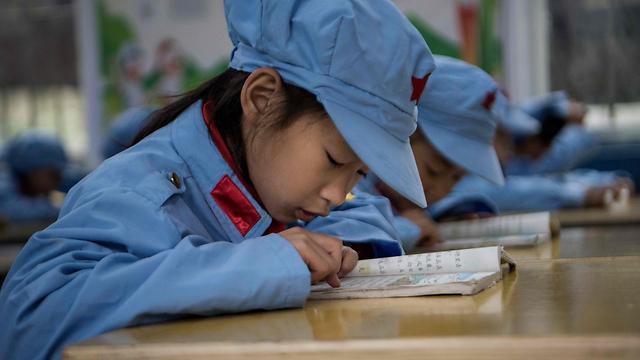 גם בישראל, גם בסין: הבנות מובילות בקריאה, הבנים במתמטיקה (צילום: AFP)