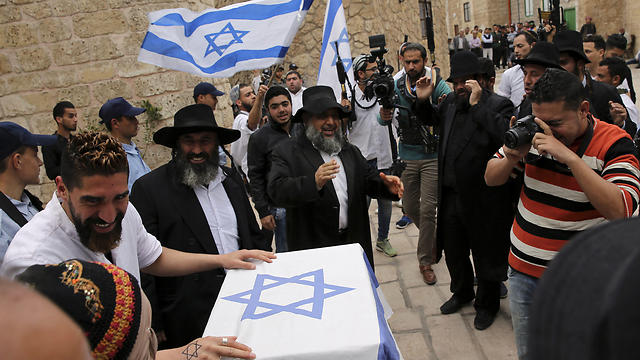 Palestinian actors dressed as ultra-Orthodox Jewish men and settlers perform. (Photo: AP)