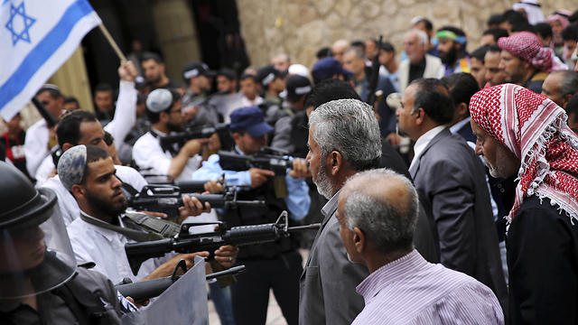 Actors create a scene of confrontation between Israeli police and settlers and Palestinians. (Photo: AP)