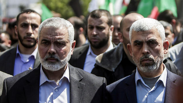 Hamas leaders Ismail Haniyeh and Yahya Sanwar. The change of leadership, alongside a new charter, allegedly symbolize a dynamic movement adapting to a changing reality (Photo: AFP)