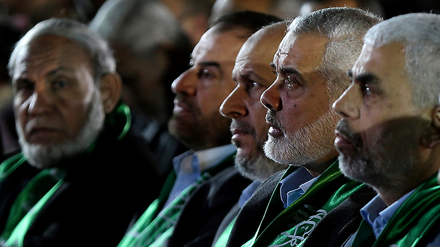Hamas officials at Fukha memorial (Photo: EPA)