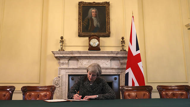 May signs letter to EU president, formally notifying him of Britain's intention to leave the bloc (Photo: AFP)