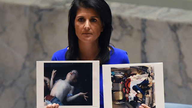 US Ambassador to the UN Nikki Haley, holding up photos victims of the attack (Photo: AFP) (Photo: AFP)