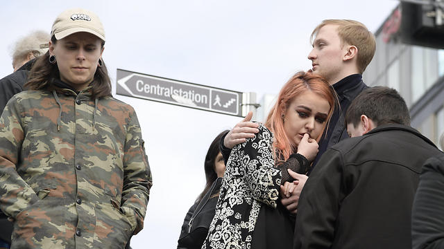 Swedish residents following the attack (Photo: EPA)