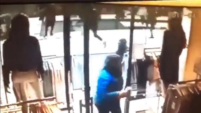 Pedestrians fleeing from the truck
