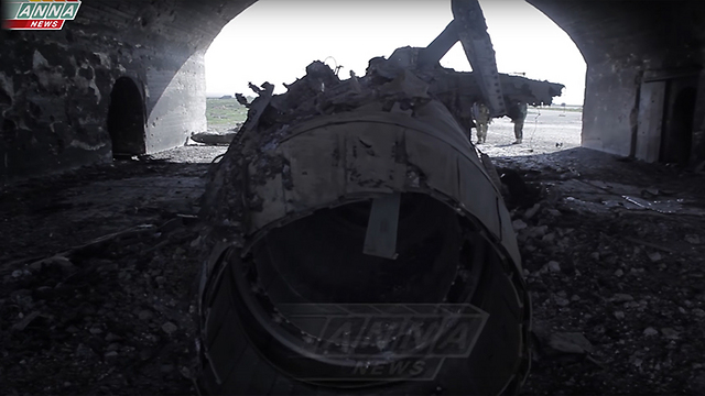 Wreckage in Sharat air base following the US' missile strike
