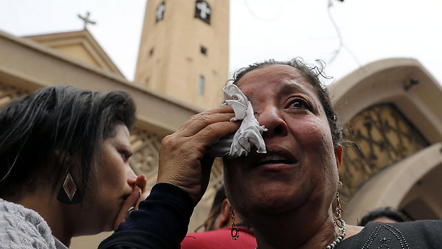 An Egyptian woman wipes her tears shortly after the explosion in the church in Tanta on Palm Sunday. (Photo: Reuters)